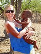 Stacy with Himba baby boy in Namibia.jpg