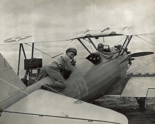 Charles C. Ebbets (3-104) on the tail of an airplane at ERAU 1942.jpg