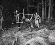 SPORTS. HUNTING  (3-210LR) Charlie carrying deer in woods w friend. c. 1926.jpg