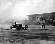SPORTS. Other (17-001LR) Auto racing-taking the checkered flag at Daytona. c. 1933.jpg