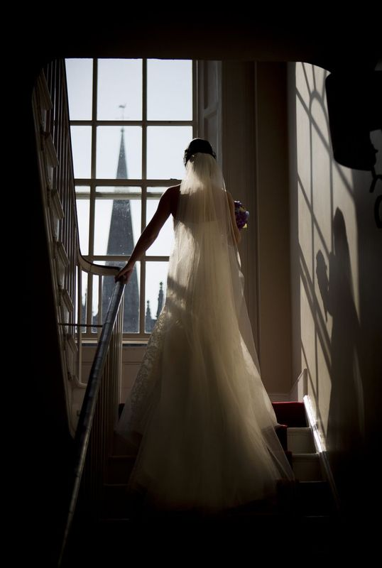 Bride-Staircase.jpg :: Here at Andrew Mackin Photography, our aim is to make your wedding day as relaxing & memorable as possible. We'll get to know you before your big day to find out your likes, needs & wants. We know that every couple & wedding are different, therefore we strive to personalise & customise every part of your day, from morning preparations, to the cutting of the cake & beyond if required.