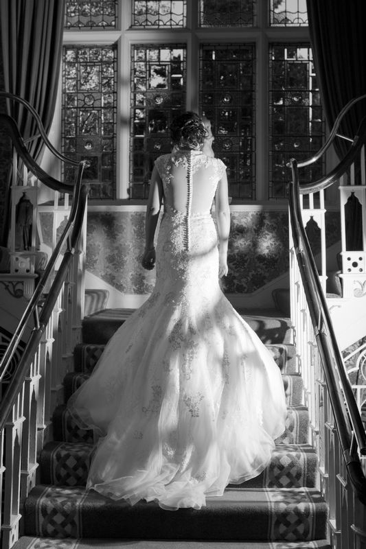 Staircase-Shadows-Dress.jpg :: Here at Andrew Mackin Photography, our aim is to make your wedding day as relaxing & memorable as possible. We'll get to know you before your big day to find out your likes, needs & wants. We know that every couple & wedding are different, therefore we strive to personalise & customise every part of your day, from morning preparations, to the cutting of the cake & beyond if required.