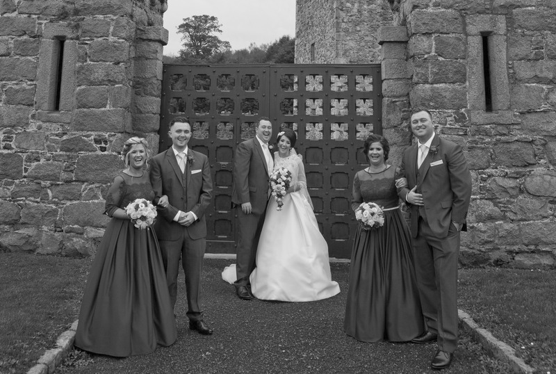 Wedding-Party-Castle-Gates.jpg :: Here at Andrew Mackin Photography, our aim is to make your wedding day as relaxing & memorable as possible. We'll get to know you before your big day to find out your likes, needs & wants. We know that every couple & wedding are different, therefore we strive to personalise & customise every part of your day, from morning preparations, to the cutting of the cake & beyond if required.