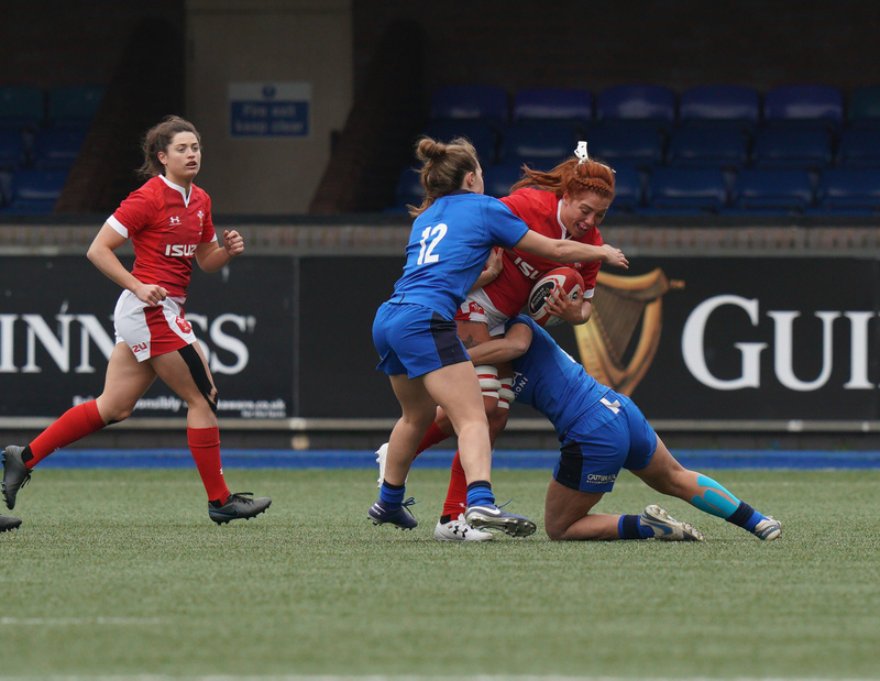 SA900924.jpg :: Georgia Evans (Wales)tackled by Beatrice Capomaggi (Italy) during the  Womens Six Nations Rugby at Cardiff Arms Park Cardiff United Kingdom on February 02 2020 Graham / GlennSports