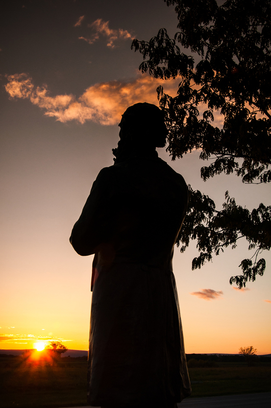 UP-8437(1).jpg :: Father Corby statue at sunset.