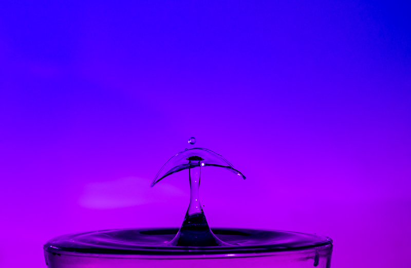 UP6_5527.jpg :: Water drop collision with a wide brime hat on.                                             #waterdrop #waterart #purple, #photooftheday, #drop, #water