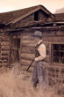 cowboy with rifle at cabin IR 1009CRW_2780 m.jpg