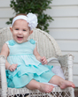 Baby girl in chair outside.jpg