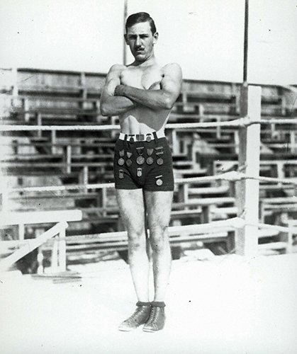 Charles C. Ebbets (3-041LR) in his wrestling outfit w medals.jpg