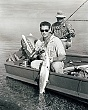 celebrities (2-019LR) Ted Williams fishing-nice bonefish at side of boat.jpg