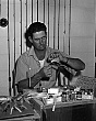 celebrities (2-016) Ted Williams tying fishing flies in his home in the Keys.jpg