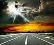 Country-road-with-a-dark-sky-34915757.jpg