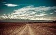 Empty-Rural-Road-Going-Through-48243419.jpg