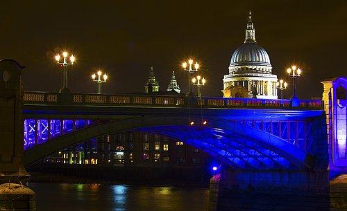 Southwark Bridge with St Pauls Cathedral behind - London.jpg