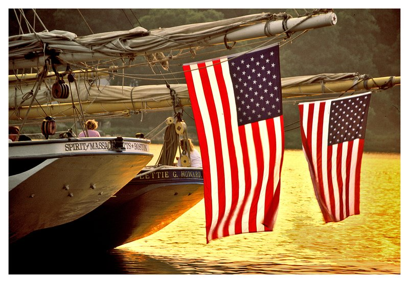 American flags sunset.jpg :: Mystic - American flags hang from the stern of ships docked at the Mystic Seaport.