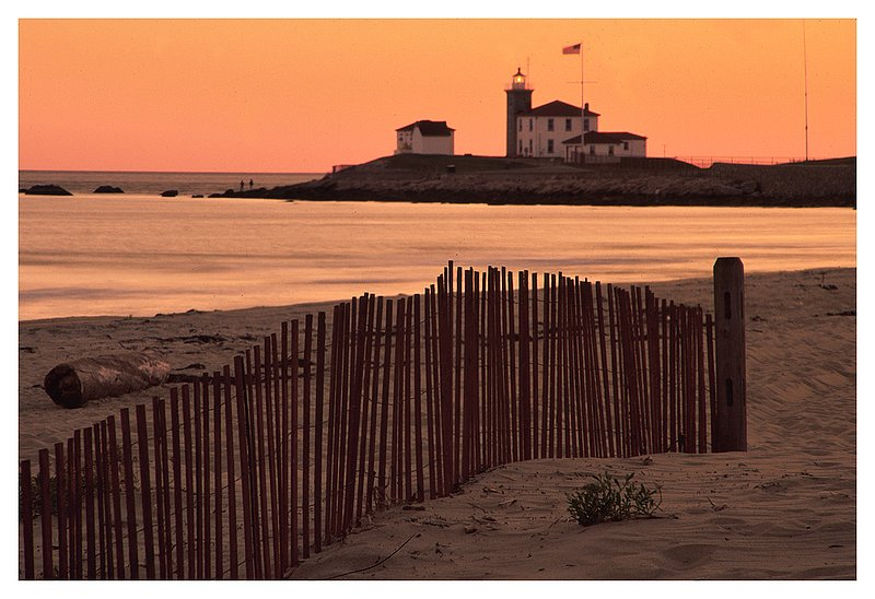 East Beach - lighthouse.jpg :: Watch Hill R.I. - The Watch Hill lighthouse with snow fencing in the foreground.