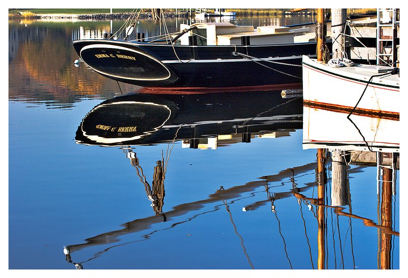 autumn river reflection.jpg :: Mystic - Historic watercraft of the Mystic Seaport reflected in Mystic River at dawn.