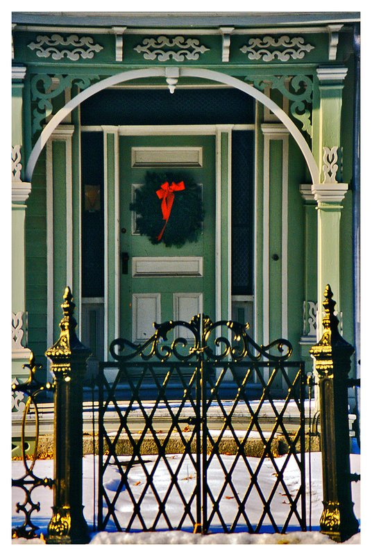 doorway-iron fence.jpg :: Mystic - An ornate iron fence frames a doorway of a shipbuilders home.