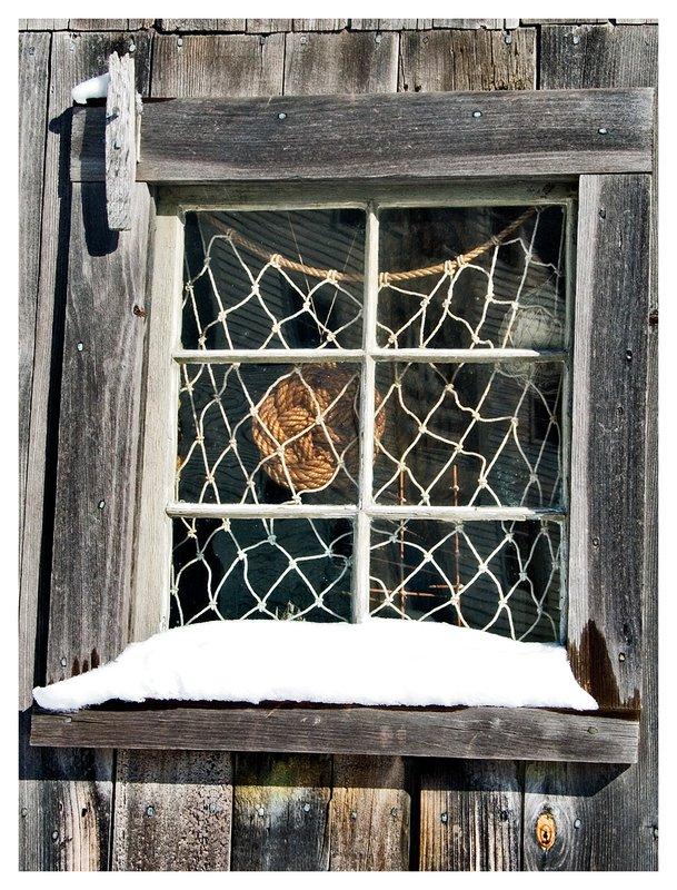fishnet-window.jpg :: Mystic - A fisherman's net in the window of a shack.