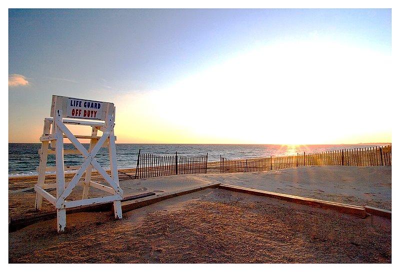 guard off duty.jpg :: Westerly R.I. - Winter sun illumines the deserted town beach.