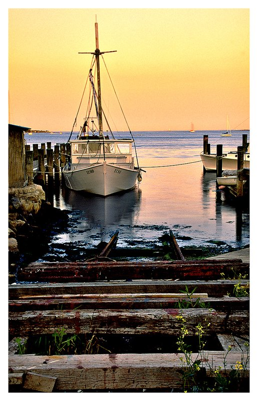 lobster boat-Noank.jpg :: Noank - A lobster boat with a marine rail in the foreground at dusk.