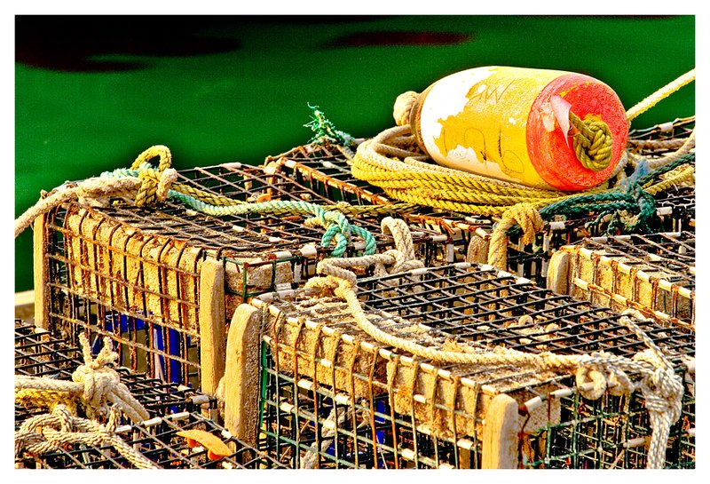 lobster pots-rope.jpg :: Stonington - Lobster pots and a colorful buoy on the town dock.