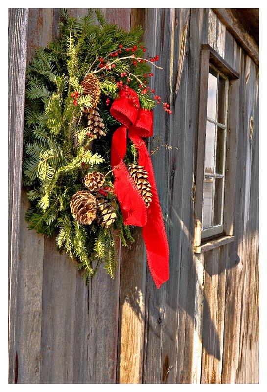 shack-Christmas wreath.jpg :: Mystic - A Christmas wreath hangs on a rustic shack.