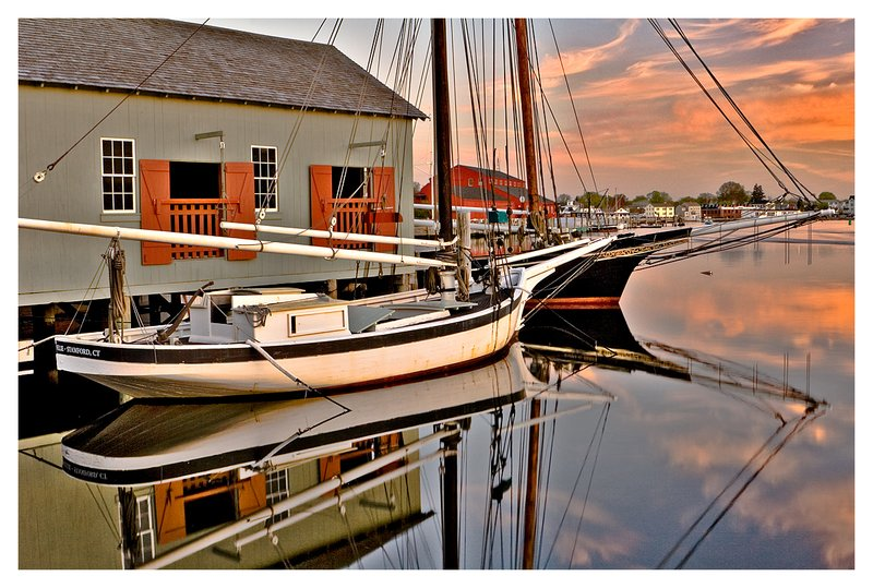 wooden boats and Mystic River.jpg :: Mystic Seaport - Watercraft of the Seaport reflected in the calm Mystic River.