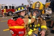 Lttle Fire Chief Looking at Christopher Bojar breathing apparatus.jpg