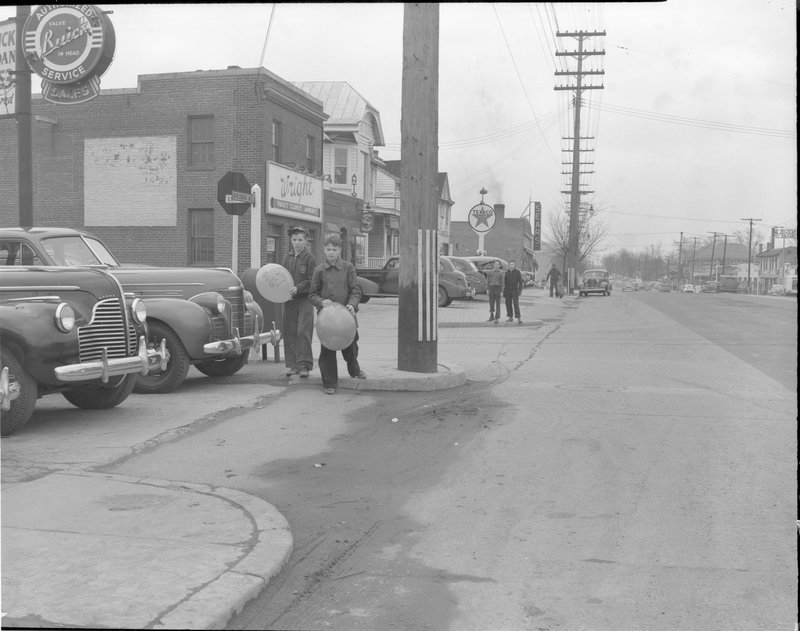112A-B Boys with Balloons Wisconsin Ave facing south at Elm Street 1940.jpg :: BOYS WITH BALLOONS 7300 WISCONSIN AVE @ WILLOW, 1939