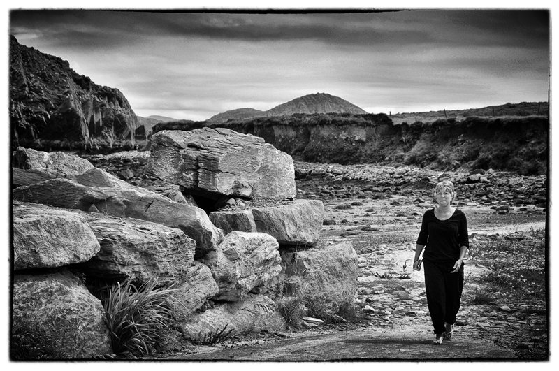 Afternoon walk.jpg :: As I wandered Ireland i captured the enchantment of this mystical Island through its people, its landmarks and its natural beauty. It beckoned me to return to my love of black and white photography.  i caught this lassie on her afternoon walk near the seashore in western Ireland.