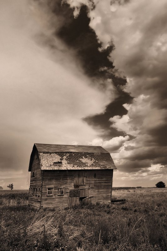 Colorado Storm.jpg :: Just outside Longmont, Colorado north of Denver I stumbled upon an old building in a field. Although I shot  in color the statement I set out to capture was lacking. After some thought I  decided to strip away the camouflage of color and Viola