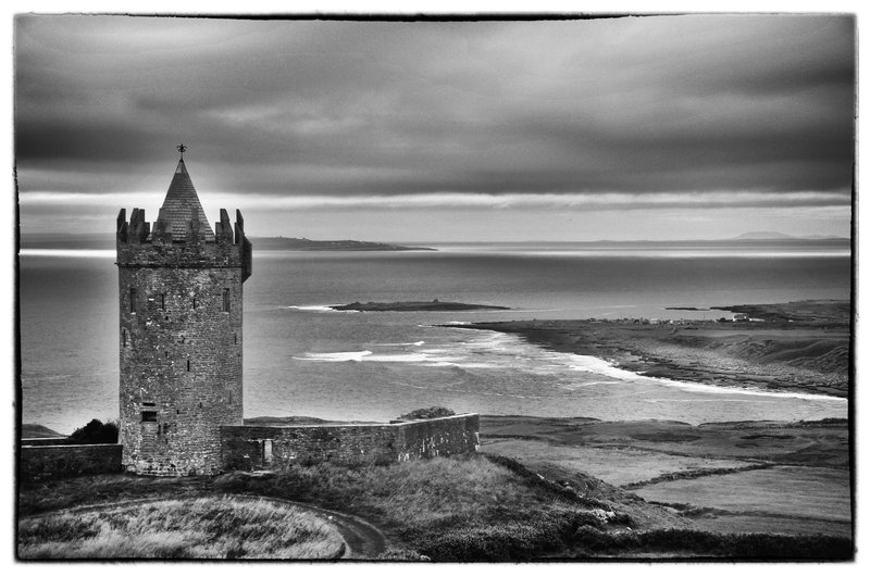Doonagore.jpg :: Scattered throughout the countryside of Ireland are castles and the remnants thereof.  Once upon a time they stood vigil, giant pillars of the past, overseeing the land and its people. This is Castle Doonagore now privately owned. Located near Doolin, Ireland
