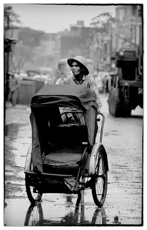 Rickshaw.jpg :: Rickshaws  a Vietnamese taxi are ever present in Saigon and throughout Vietnam, for a few Piastres one can ride in relative comfort in an enclosed or open ride.