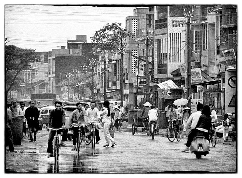 Saigon Streets.jpg :: The hustle and bustle on the streets of Saigon is a twenty four hour event, people of all walks of life trying to make a living and attending to their chores of the day.