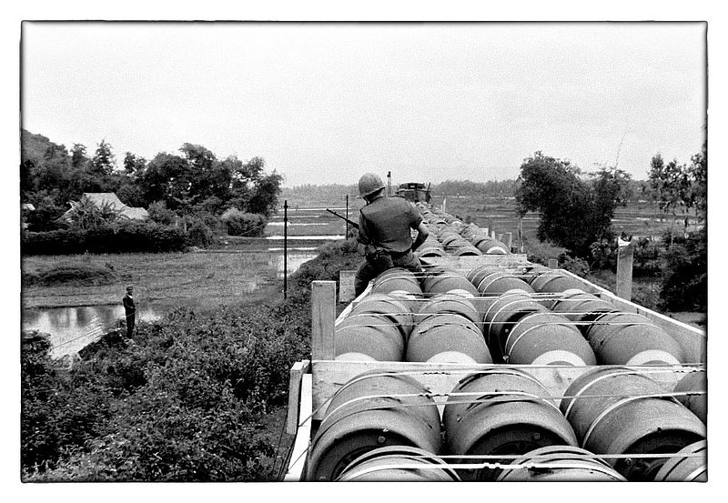 War.jpg :: Transporting 2000lb bombs North from Saigon by rail along the coast of Vietnam and the South China Sea.