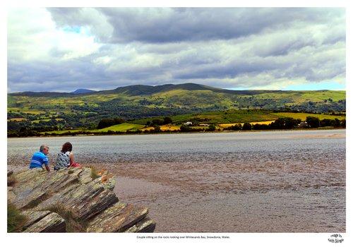 Couple-sitting-on-the-rocks-Whitesands-Bay.jpg
