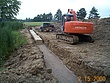 Laying the First Course of the reclaimed Bridgestone installation at Powderhorn Country Club.jpg