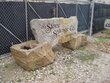 Reclaimed Bridgestone sign with the STONE SALVAGE Company etched in a slab in planter pedestals.jpg