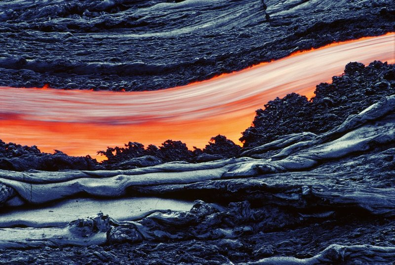 12-Molten-River.jpg :: This is the lava flow that kept me trapped overnight on Kilauea, as I was waiting for the magic light, so I could take a slow exposure of the moving river of lava. By the time I had the photograph I wanted, the river of lava had cut off my escape route. I ended up sleeping on the hot lava so I didn't freeze. I felt like John Muir trapped on Mt. Shasta, sleeping on a steam vent... Ah, memories..