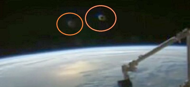2-10-16 I.S.S. AND ALIEN CRAFT IN ORBIT--ROB ROBINSON SOURCE.jpg